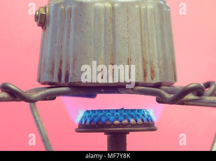 Moka pot on gas stove - Stock Photo
