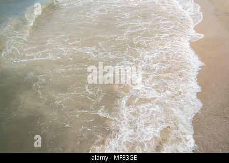 An abstract or concept image of an aerial view of the ocean as it meets the shore. - Stock Photo