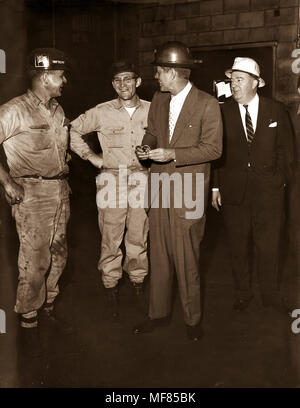 PC 1788       April 1960 John F. Kennedy, wearing hard hat, talks with miners in West Virginia during the Presidential Primary campaign.  Please credit 'John F. Kennedy Presidential Library and Museum, Boston' - Stock Photo