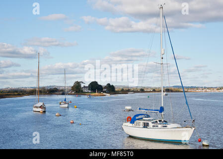 yachts moored in front of Turf Lock at the entrance to the Exeter Canal on the River Exe in Devon, England on a sunny autumn day, with blue skies - Stock Photo