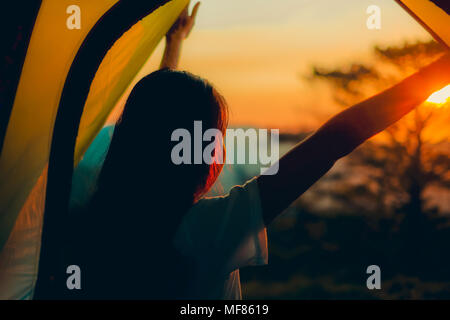 Beautiful sunrise and view from inside a tent on the mountains. Royalty high quality free stock image of the view from inside camp in the morning - Stock Photo
