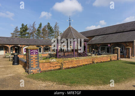 The courtyard at the Heart Of The Shires Shopping Village, out of town shops set in old farm buildings; Northamptonshire, UK - Stock Photo