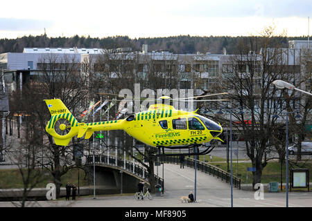 FinnHEMS medical helicopter takes off Salo Market Square in the evening in Salo, Finland - April 22, 2018. - Stock Photo