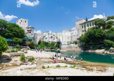 The Stari Most, Old Bridge from the banks of the Neretva River in Mostar, Bosnia and Herzegovina - Stock Photo