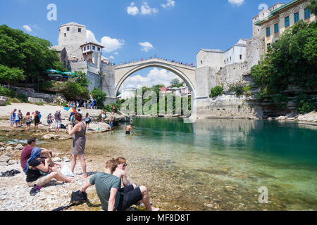 Stari Most, Old Bridge from the banks of the River Neretva in Mostar, Bosnia and Herzegovina - Stock Photo