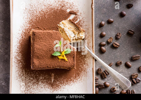 Tiramisu Cake Traditional Italian Dessert with Mascarpone Cheese and Espresso Coffee - Stock Photo