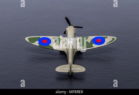 Miniture diecast replica of a second world war RAF Spitfire fighter. - Stock Photo