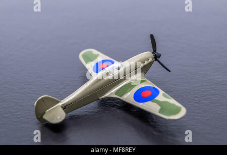 Miniture diecast replica of a second world war RAF Hurricane fighter. - Stock Photo