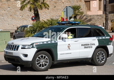 Alcudia, Majorca, Spain. 2018. Traffic cops in a green and white guadia traffic police car - Stock Photo
