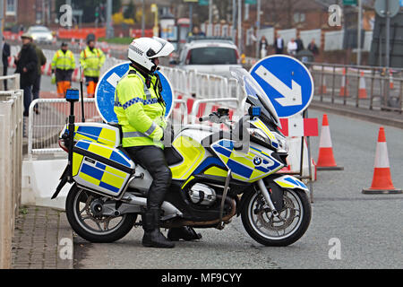 British motorcycle police officer on his BMW motorbike at the Grand National meeting in Liverpool 2018 - Stock Photo