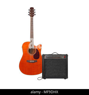 Music and sound - Musical instrument Orange acoustic guitar, amplifier and cable front view isolated on a white background. Stock Photo
