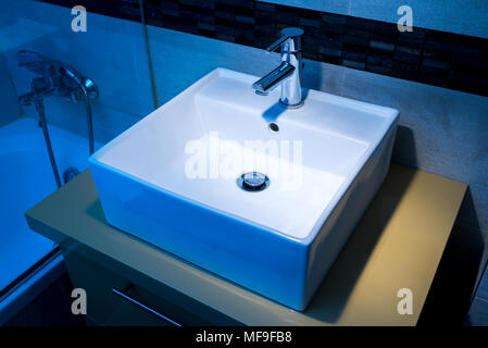 modern washbasin on the pedestal in the bathroom - Stock Photo