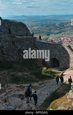 Tourists visiting the castle of Monsanto in Portugal - Stock Photo