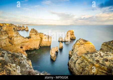 Stunning cliffs and arches in Ponta da Piedade by Atlantic Ocean, Lagos, Algarve, Portugal - Stock Photo