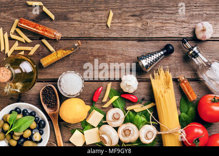 Italian food ingredients for the preparation pasta on wooden background - Stock Photo