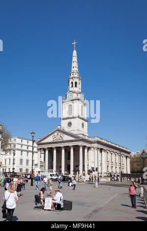 Exterior view of St-Martin-in-the-Fields church on a sunny day with tourists in Trafalgar Square, London - Stock Photo