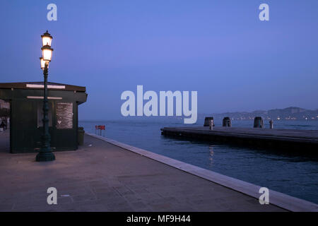 Promenade along San Basilio in Venice, Italy, during blue hour - Stock Photo