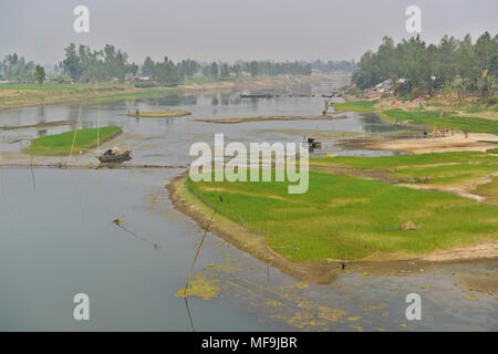 Bogra, Bangladesh - February 28, 2017: The Bangali River is embracing a slow death due to lack of dredging and/or as a consequence of human encroachme - Stock Photo