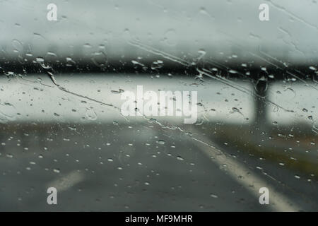 Driving under a bridge on a rainy day - Stock Photo