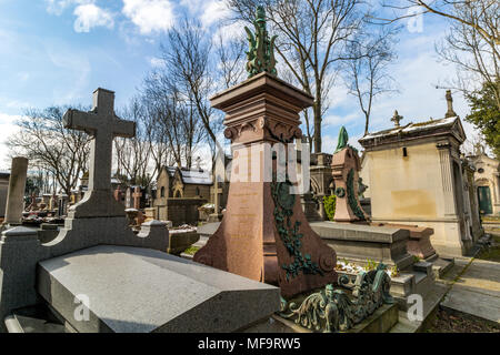 Tombstones at  Père Lachaise cemetery, the largest and most visited cemetery  in Paris - Stock Photo