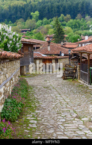 Zheravna, Bulgaria - architectural reserve of rustic houses and narrow cobbled streets from the Bulgarian national revival period - Stock Photo