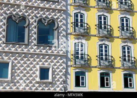 Casa dos Bicos and the building door, Casa das Varandas. Lisbon, Portugal - Stock Photo