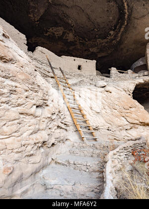 Ladder to ancient cliff dwelling ruins at Gila Cliff Dwellings National Monument, Silver City New Mexico in winter - Stock Photo