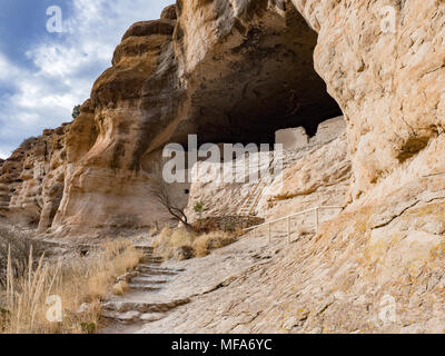 Ancient cliff dwelling ruins at Gila Cliff Dwellings National Monument, Silver City New Mexico in winter on a sunny day - Stock Photo