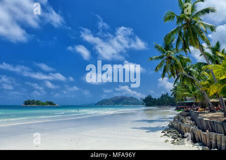 White coral sand on а tropical beach. Praslin island, Seychelles - Stock Photo