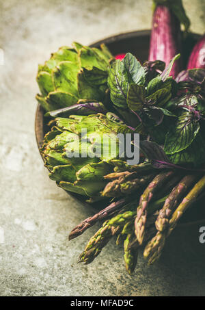 Flat-lay of green and purple vegetables on plate, selective focus - Stock Photo