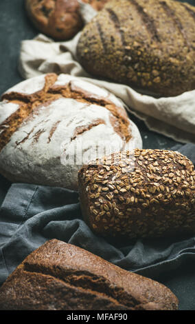 Close-up of Rye, wheat and multigrain rustic bread loaves - Stock Photo