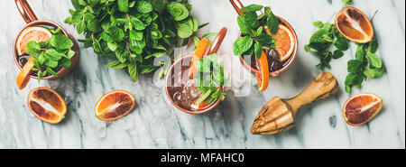 Blood orange Moscow mule alcohol cocktails, marble background, top view - Stock Photo