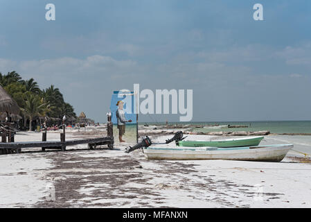 fishing boats on the beach of holbox island, mexico - Stock Photo