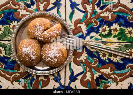 Kemalpasa dessert is prepared from a dough of flour, unsalted cheese, semolina, egg, water and baking powder. - Stock Photo