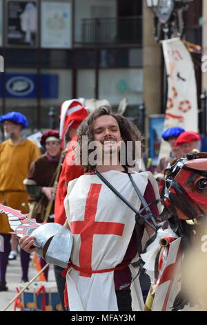 St George makes himself known to the crowd at Chester's St George's day parade - Stock Photo