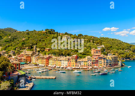 Panoramic view of Portofino, is an Italian fishing village, Genoa province, Italy. A vacation resort with a picturesque harbour and with celebrity and - Stock Photo