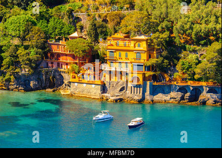 Aerial view of Portofino, an Italian fishing village, Genoa province, Italy. A vacation resort with a picturesque harbour and with celebrity and artis - Stock Photo