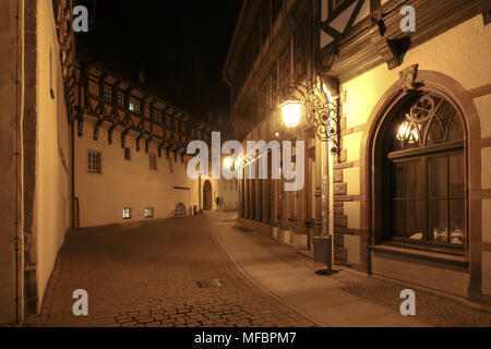Wernigerode, Germany - 24 April 2018: Night view into a medieval alley of the popular tourist town Wernigergerode in the low mountain range Harz, Germ - Stock Photo