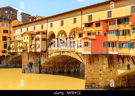 Ponte Vecchio (Old Bridge), a Medieval stone closed-spandrel segmental arch bridge over the Arno River, in Florence, Italy. - Stock Photo