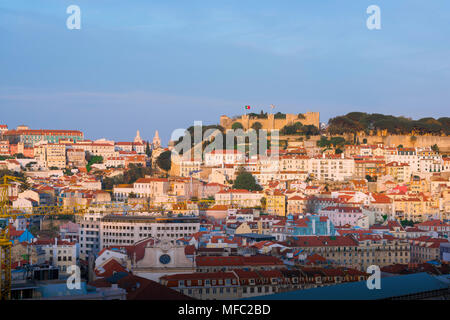 Lisbon skyline, view of the Castelo de Sao Jorge at sunset with the crowded hillside buildings of the Mouraria quarter sited below, Lisbon, Portugal.