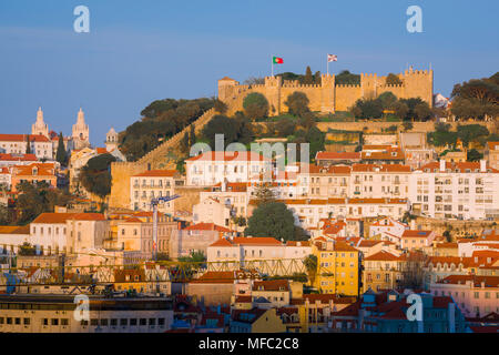 Lisbon Portugal castle, view at sunset of the Castelo de Sao Jorge sited on a hill above the old town Mouraria quarter in Lisbon, Portugal.