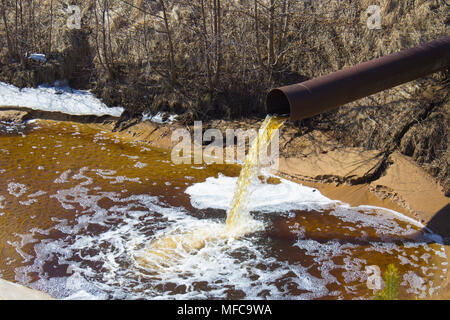 The Industrial Wastewater is Discharged from the Pipe - Stock Photo