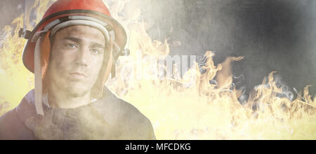 Composite image of serious fireman - Stock Photo