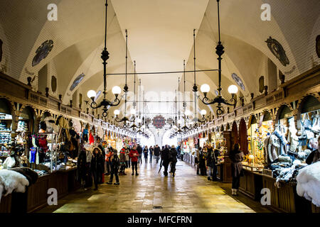 Krakow, Poland - Circa January, 2014: The crowded Cloth Hall gallery, or Sukiennice, located on Rynek Glowny, the main market square in the old town o - Stock Photo