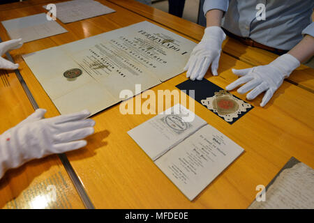 25 April 2018, Germany, Trier: Restorators prepare the doctoral certificate of Karl Marx and the seal for the large Karl Marx exhibition at the Rheinische Landesmuseum Trier. According to its organizers, Rhineland-Palatinate's state exhibition 'Karl Marx 1818 - 1883. Life. Work. Times' is the first ever historico-cultural exhibition on the thinker. It can be seen at the Rheinische Landesmuseum Trier and at the Simeonstift Trier city museum. Photo: Harald Tittel/dpa - Stock Photo