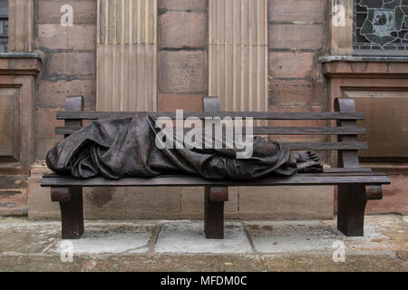 St. Annes Sq, Manchester, UK. 25th. April 2018: Homeless Jesus sculpture in St. Annes Square Manchester - a social comment on the homeless problem in the city. Homeless Jesus, also known as Jesus the Homeless, is the work of a Canadian sculptor and devout Catholic, Timothy Schmalz, whose original casting of Jesus on a park bench was installed in Toronto. Further casts have been made from the mould and have appeared in several cities around the world including the Papal Offices in Rome.. Credit: Dave Ellison/Alamy Live News