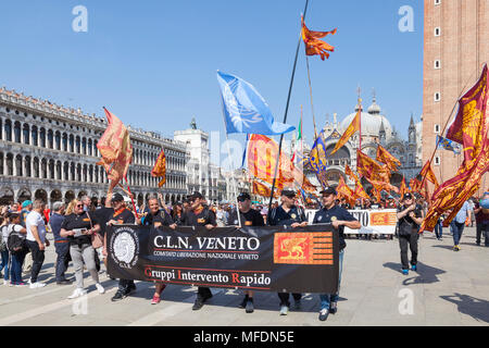 Venice, Veneto, Italy. 25th April 2018. Festivities in St Marks Square marking Liberation Day (Festa della Liberazione) commemorating the end of World War II and the Nazi occupation of Italy and Commemorating their fallen soldiers. For Venice it is also the Feast of St Mark (Festa di San Marco) the patron saint of the city marking the anniversary of his death. iCLN group activating for the liberation of Venice fro Italy as a democracy in  Piazza San Marco . Credit MCpics/Alamy Live News - Stock Photo