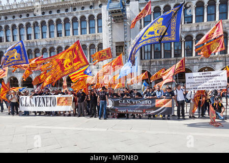 Venice, Veneto, Italy. 25th April 2018. Festivities in St Marks Square marking Liberation Day (Festa della Liberatione) commemorating the end of World War II and the Nazi occupation of Italy and Commemorating their fallen soldiers. For Venice it is also the Feast of St Mark (Festa di San Marco) the patron saint of the city marking the anniversary of his death. Activists from CLN holding banners  promoting the liberation of Venice from Italy as a democracy in  Piazza San Marco. Credit MCpics /Alamy Live News - Stock Photo