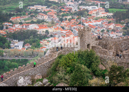 Castle Of The Moors, view of tourists exploring the castle walls of the Castelo dos Mouros (Castle Of The Moors), Sintra, Portugal. - Stock Photo