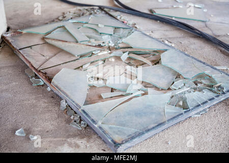 A smashed window inside a bombed out building from the Bosnian War in Mostar, Bosnia and Herzegovina - Stock Photo